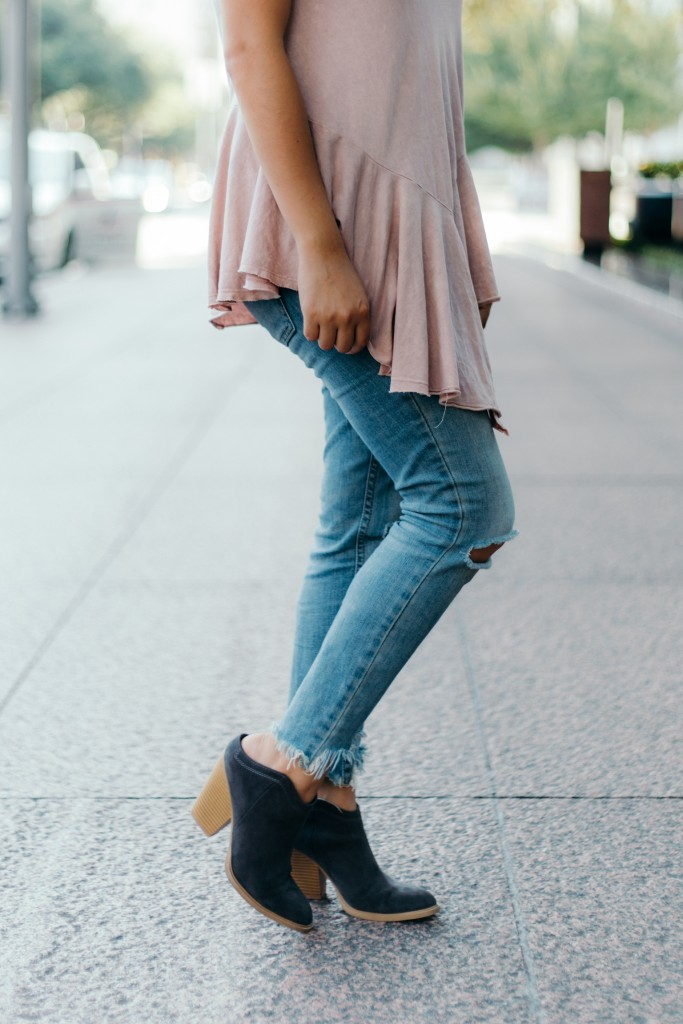 Blush peplum with distressed jeans and ankle boots